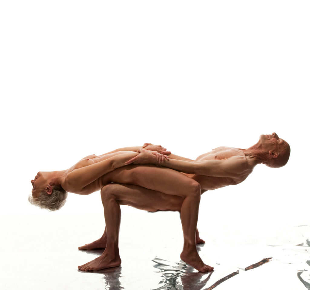 Inner Spirit Photo by Mark Laurie Boudoir nude older couple in yoga pose in white set with reflective floor in Calgary, Canada.