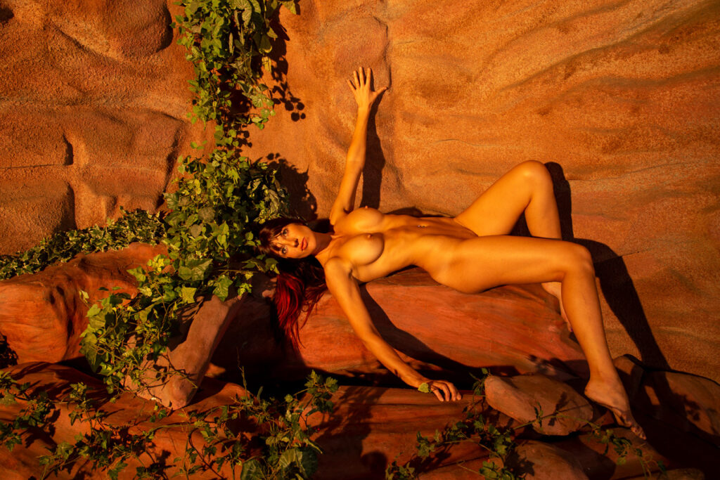 Inner Spirit Photo by Mark Laurie Boudoir nude woman lays in canyon set with orange lighting in Calgary, Canada studio.