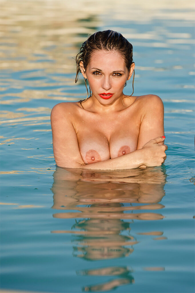 Inner Spirit Photo by Mark Laurie Boudoir nude model arms crossed under bare breasts wet in lake.