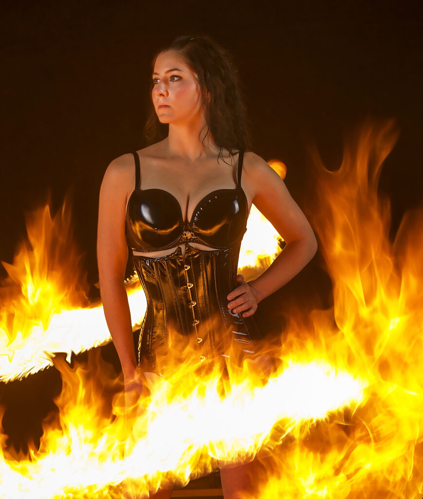 : Inner Spirit Photo by Mark Laurie Boudoir woman black latex corset surrounded by flames in Calgary studio.